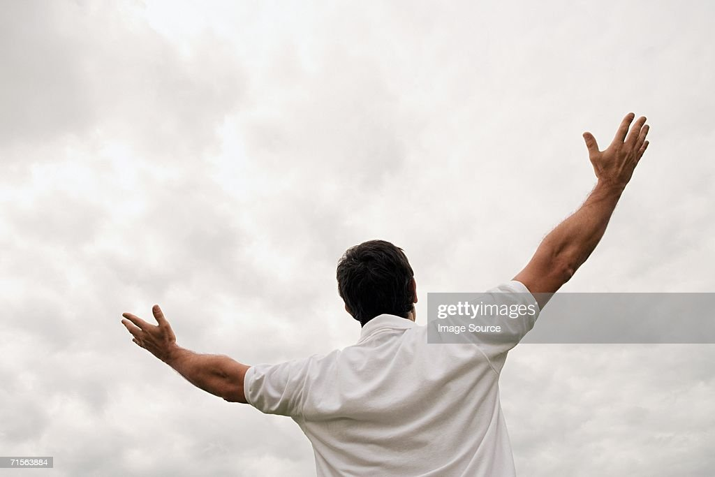 Man worshipping with open arms : Stock Photo