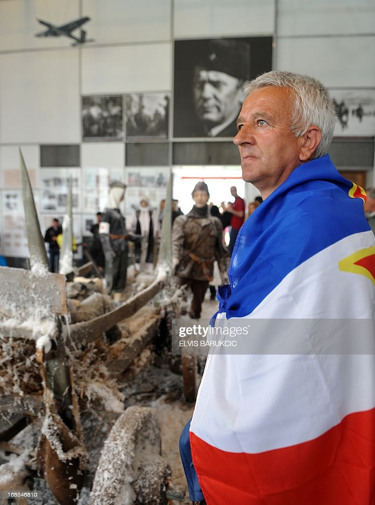 A man wrapped in the ex-Yugoslav flag visits the museum of the Southern-Bosnian town of Jablanica, on May 11, 2013. A crowd of several thousand socialist supporters and sympathisers gathered in Jablanica to commemorate the 70th anniversary of The Battle on the river Neretva, one of the most famous battles of World War II in Yugoslavia. The battle was fought by Tito's Partisans who were vastly outnumbered and outgunned by German forces and their domestic helpers. The Partisans carried a large number of wounded fighters and were followed by several thousands of civillians who were fleeing in front of a German offensive.