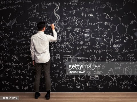 Man writes mathematical equations on chalkboard