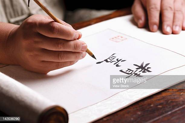 Man writing calligraphy
