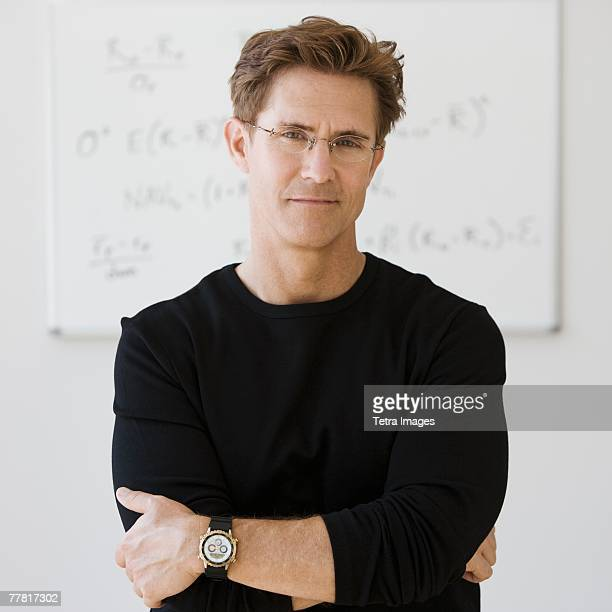 Man writing formulae on whiteboard