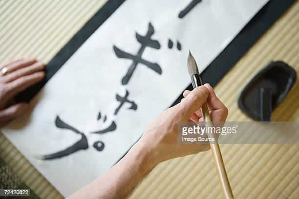 Man writing in Japanese script
