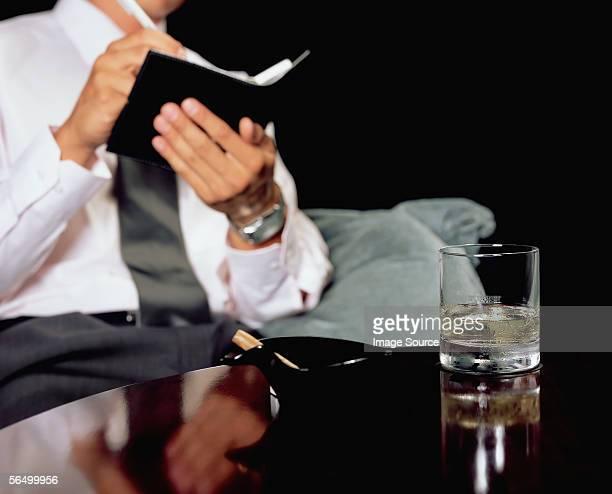 Man writing in personal organiser