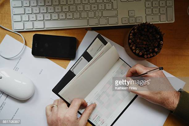 Man writing out cheque