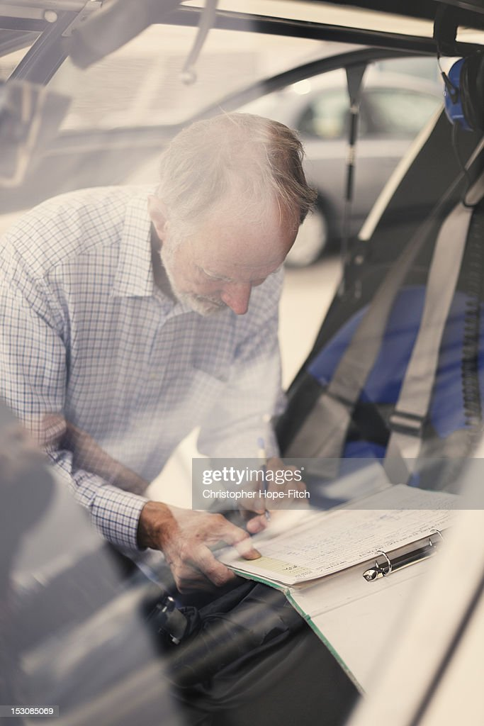 Man writting on paper : Stock Photo