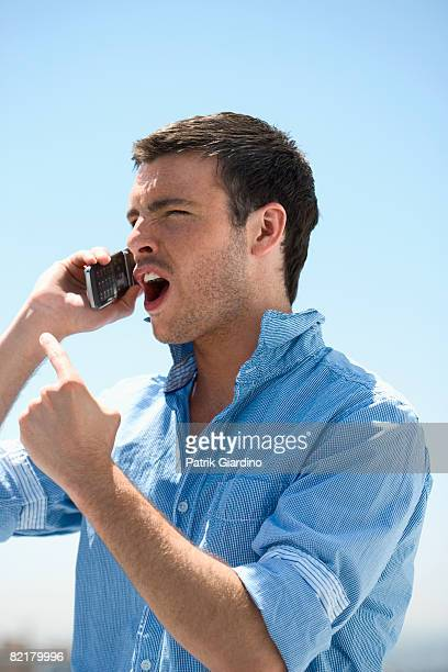 Man yelling on mobile phone