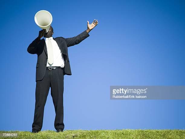 Man yelling through bullhorn
