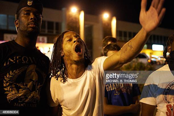A man yells during a protest action on West Florissant Avenue on August 11 2015 in Ferguson Missouri The embattled town looks to recover after...