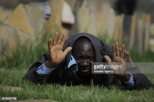 A man yields as Supporters of political opposition leader Raila Odinga who are trying to gather near the country's main airport and Uhuru park to...