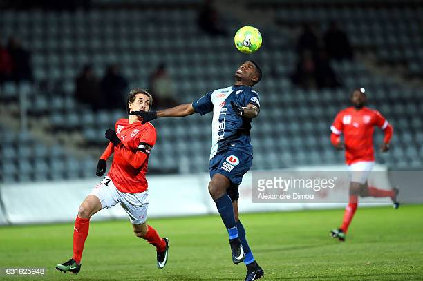 Mana Dembele of Le Havre and Fethi Harek of Nimes during the Ligue 2 match between Nimes Olympique and Le Havre AC on January 13 2017 in Nimes France