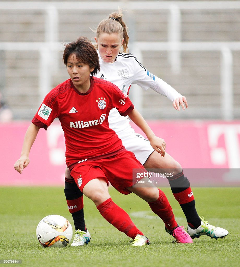 <a gi-track='captionPersonalityLinkClicked' href=/galleries/search?phrase=Mana+Iwabuchi&family=editorial&specificpeople=6733578 ng-click='$event.stopPropagation()'>Mana Iwabuchi</a> of Bayern Munich is challenged by Marisa Henrike Ewers of Bayer Leverkusen during the Women's Bundesliga match at Gruenwalder Street Stadium on May 01, 2016 in Munich, Bavaria.