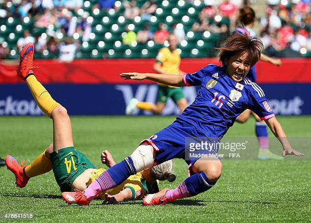 Mana Iwabuchi of Japan and Alanna Kennedy of Australia battle for the ball during the FIFA Women's World Cup Canada 2015 quarter final match between...