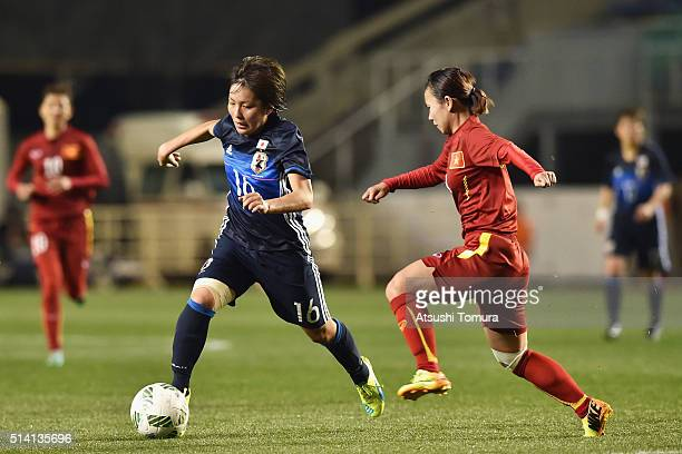 Mana Iwabuchi of Japan and Nguyen Thi Lieu of Vietnam compete for the ball during the AFC Women's Olympic Final Qualification Round match between...