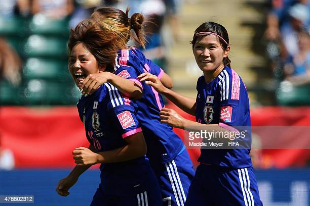 Mana Iwabuchi of Japan celebrates her goal with Nahomi Kawasumi during the FIFA Women's World Cup Canada 2015 quarter final match between Japan and...