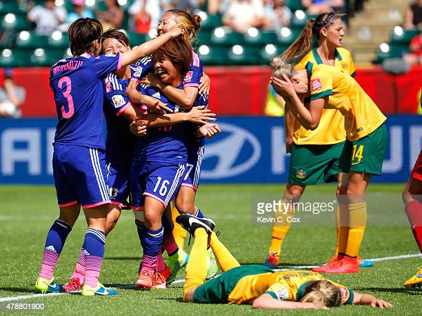Mana Iwabuchi of Japan celebrates scoring a goal against Australia during the FIFA Women's World Cup Canada 2015 Quarter Final match between...