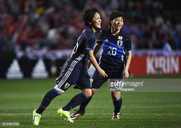 Mana Iwabuchi of Japan celebrates scoring her team's first goal during the AFC Women's Olympic Final Qualification Round match between Japan and...