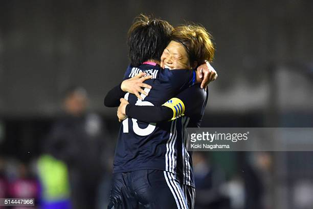 Mana Iwabuchi of Japan celebrates scoring her team's first goal with her team mate Aya Miyama during the AFC Women's Olympic Final Qualification...