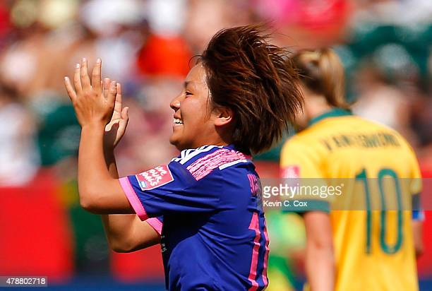 Mana Iwabuchi of Japan celebrates scoring the first goal against Australia during the FIFA Women's World Cup Canada 2015 Quarter Final match between...