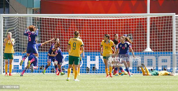 Mana Iwabuchi of Japan celebrates with her teammates after scoring a goal against Australia during the FIFA Women's World Cup Canada Quarter Final...