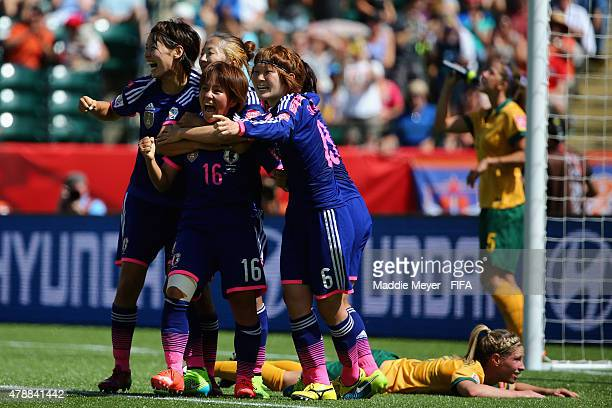 Mana Iwabuchi of Japan celebrates with teammates after scoring a goal as Elise KellondKnight of Australia reacts on the pitch during the FIFA Women's...
