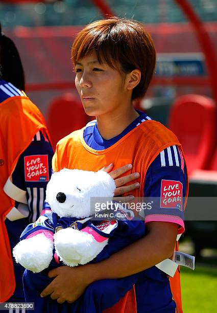 Mana Iwabuchi of Japan holds a bear wearing a shirt in honor of Kozue Ando who broke her leg in an earlier match prior to the FIFA Women's World Cup...