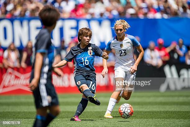 Mana Iwabuchi of Japan kicks while under pressure from Allie Long of the US Women's National Team during the first half of a friendly match on June 5...