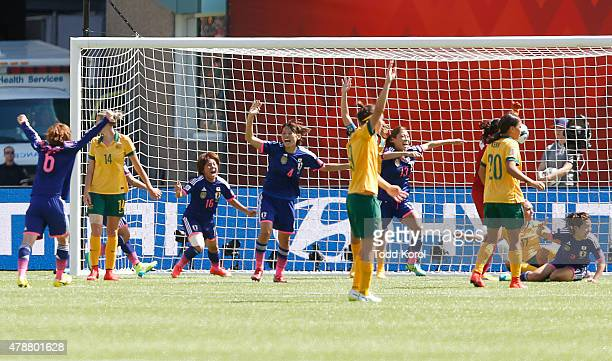 Mana Iwabuchi of Japan reacts after scoring a goal against Australia during the FIFA Women's World Cup Canada Quarter Final match between Australia...