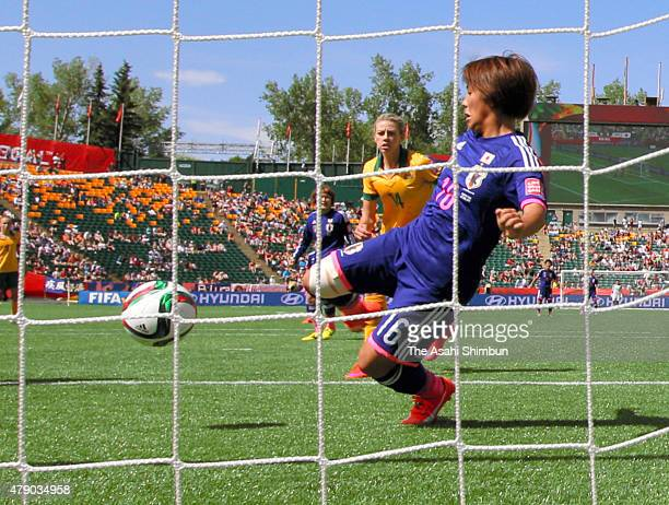 Mana Iwabuchi of Japan scores her team's first goal during the FIFA Women's World Cup Canada 2015 Quarter Final match between Australia and Japan at...