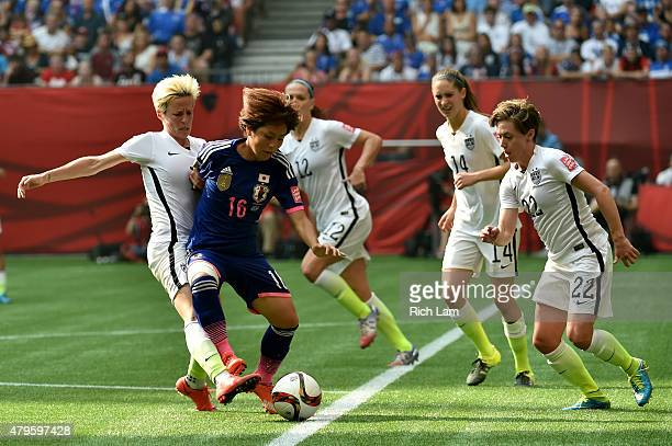 Mana Iwabuchi of Japan with the ball against Megan Rapinoe of the United States in the second half in the FIFA Women's World Cup Canada 2015 Final at...