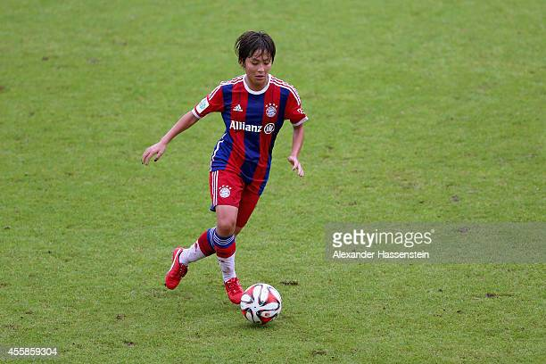 Mana Iwabuchi of Muenchen battles for the ball during the Allianz FrauenBundesliga match between FC Bayern Muenchen and 1899 Hoffenheim at Stadion an...