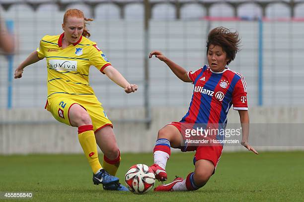 Mana Iwabuchi of Muenchen battles for the ball with Lena Weiss of Hoffenheim during the Allianz FrauenBundesliga match between FC Bayern Muenchen and...