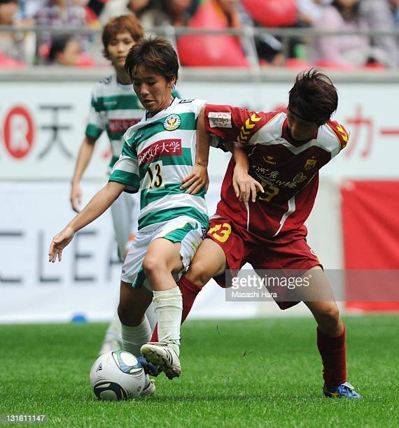 Mana Iwabuchi of NTV Beleza andChiaki Minamiyama of INAC Kobe Leonessa compete for the ball during the Nadeshiko League match between INAC Kobe...
