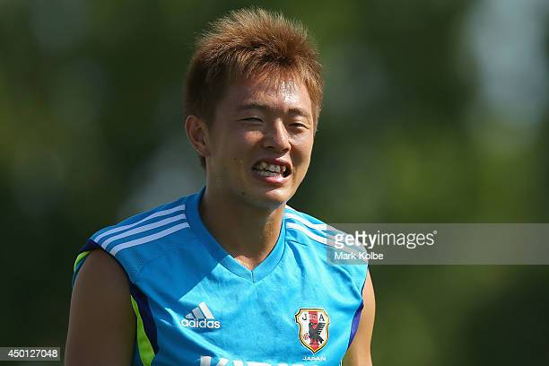 Manabu Saito laughs during a Japan training session at North Greenwood Recreation Aquatic Complex on June 5 2014 in Clearwater Florida