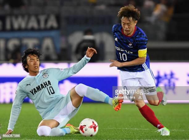 Manabu Saito of Yokohama FMarinos and Shunsuke Nakamura of Jubilo Iwata compete for the ball during the JLeague J1 match between Yokohama FMarinos...