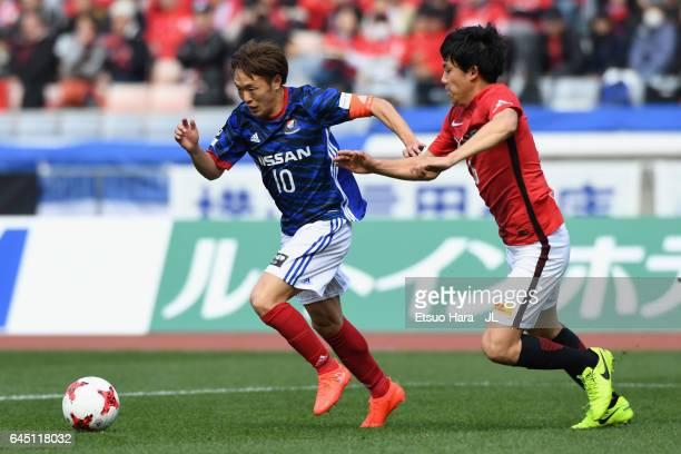 Manabu Saito of Yokohama FMarinos and Wataru Endo of Urawa Red Diamonds batte for the ball during the JLeague J1 match between Yokohama FMarinos and...