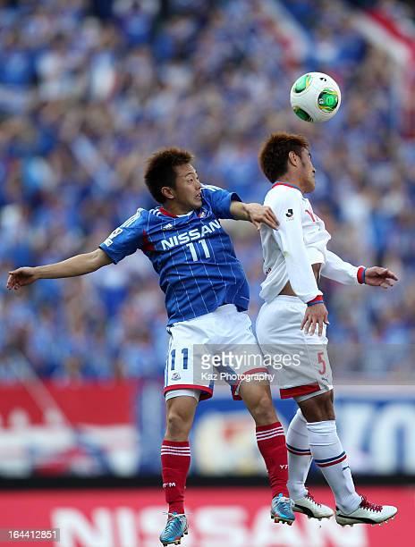 Manabu Saito of Yokohama FMarinos and Yuichi Komano of Jubilo Iwata compete for the ball during the JLeague match between Yokohama FMarinos and...