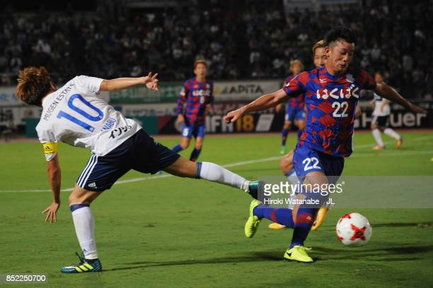 Manabu Saito of Yokohama FMarinos and Yuta Koide of Ventforet Kofu compete for the ball during the JLeague J1 match between Ventforet Kofu and...