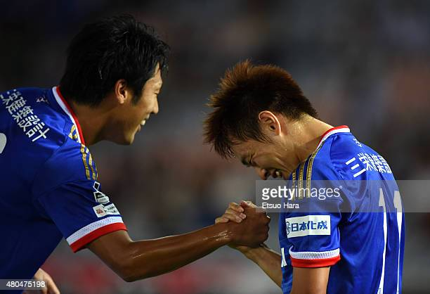 Manabu Saito of Yokohama FMarinos celebrates scoring his team's first goal with his team mate Sho Ito during the JLeague match between Yokohama...