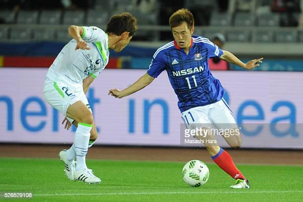 Manabu Saito of Yokohama FMarinos in action during the JLeague match between Yokohama FMarinos and Shonan Bellmare at the Nissan stadium on April 30...