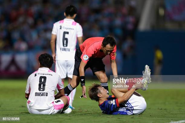 Manabu Saito of Yokohama FMarinos lies injured during the JLeague J1 match between Yokohama FMarinos and Sagan Tosu at Nippatsu Mitsuzawa Stadium on...