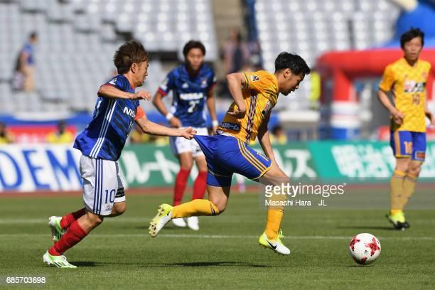 Manabu Saito of Yokohama FMarinos pulls a pants of Shingo Tomita of Vegalta Sendai during the JLeague J1 match between Yokohama FMarinos and Vegalta...