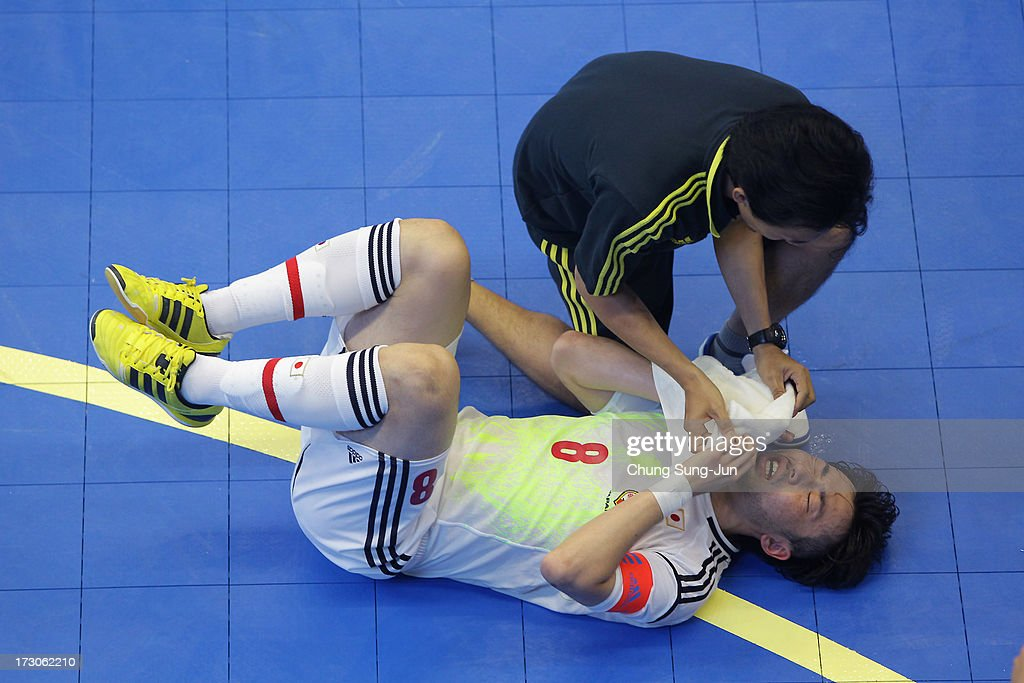 Manabu Takita # 8 of Japan lies injured during the Men's Futsal Gold Medal match against Iran at Songdo Global University Campus Gymnasium during day eight of the 4th Asian Indoor & Martial Arts Games on July 6, 2013 in Incheon, South Korea.