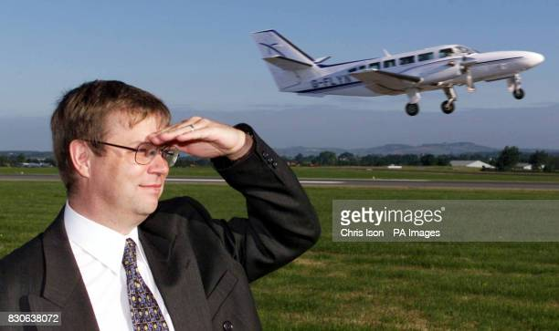 Management consultant Chris Clifton watches his Cessna Caravan plane take off from Exeter airport Clifton was so disgruntled with the train services...