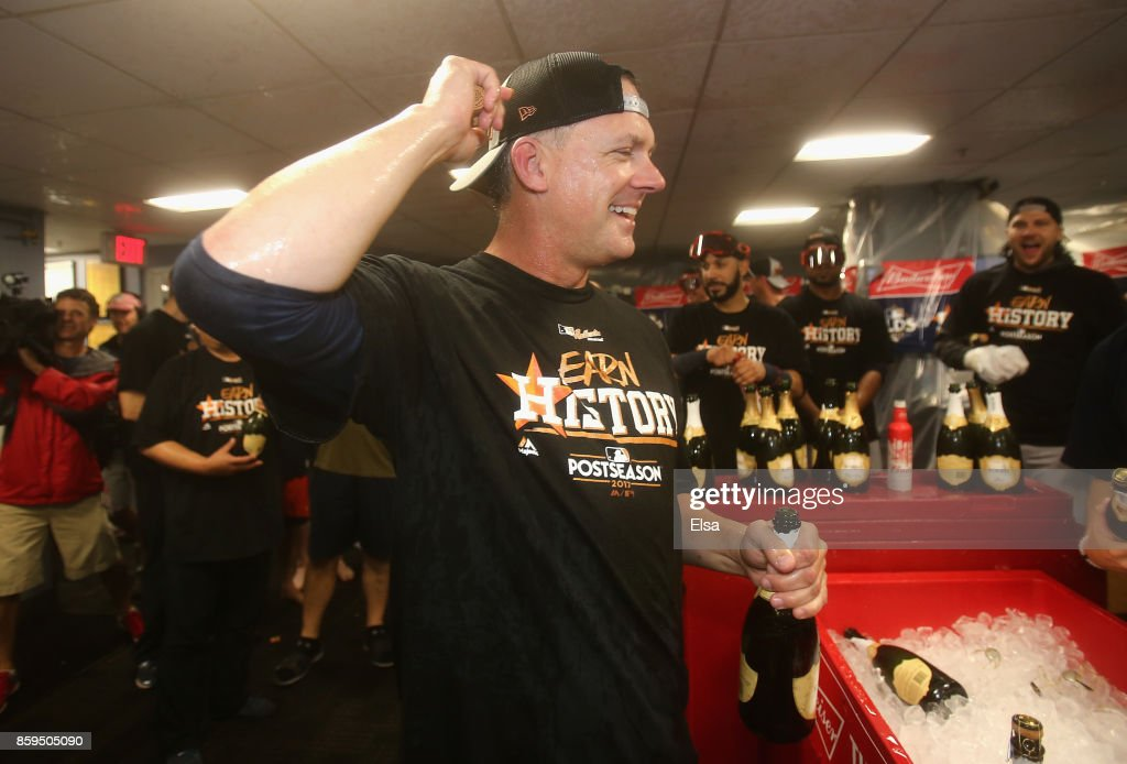 Manager A.J. Hinch of the Houston Astros celebrates in the clubhouse after defeating the Boston Red Sox 5-4 in game four of the American League Division Series at Fenway Park on October 9, 2017 in Boston, Massachusetts. The Astros advance to the American League Championship Series.