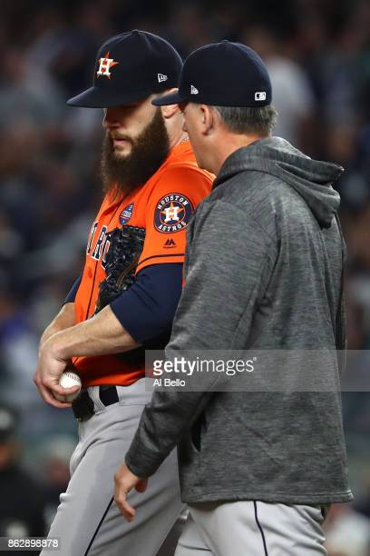 Manager AJ Hinch of the Houston Astros speaks to Dallas Keuchel during the fifth inning against the New York Yankees in Game Five of the American...