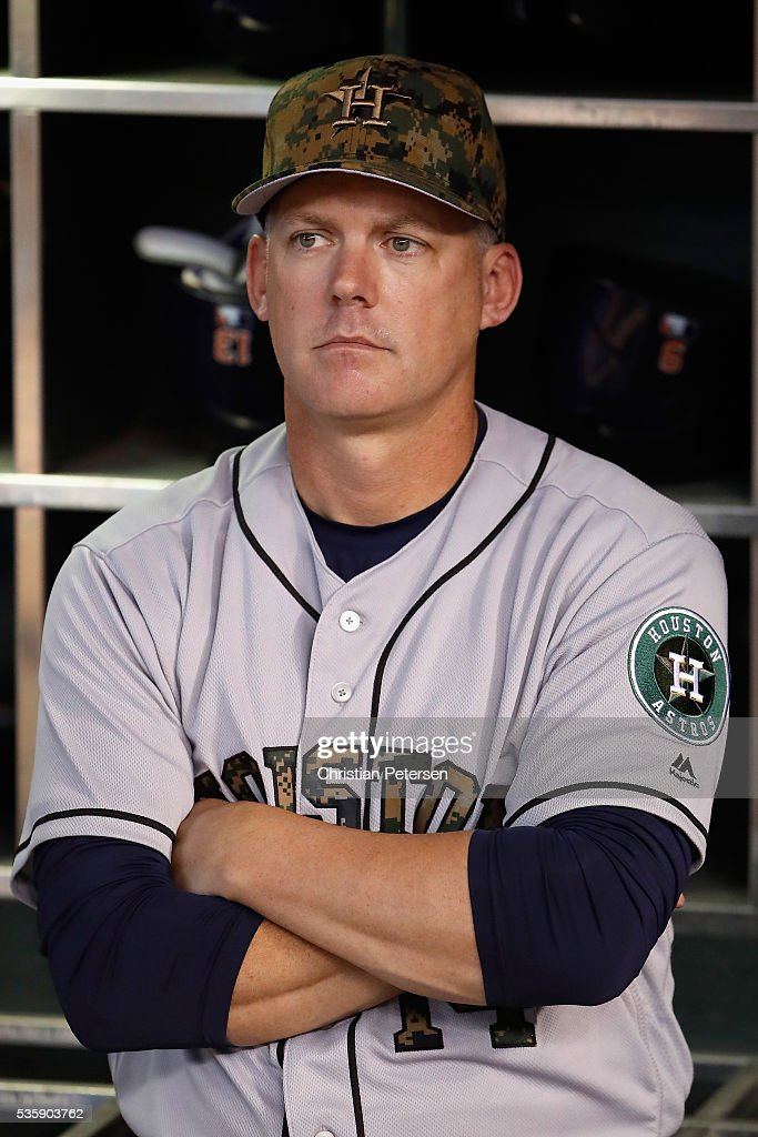 Manager <a gi-track='captionPersonalityLinkClicked' href=/galleries/search?phrase=A.J.+Hinch&family=editorial&specificpeople=2465893 ng-click='$event.stopPropagation()'>A.J. Hinch</a> #14 of the Houston Astros stands in the dugout before the MLB game against the Arizona Diamondbacks at Chase Field on May 30, 2016 in Phoenix, Arizona.