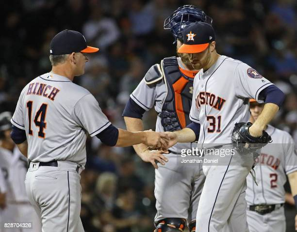 Manager AJ Hinch of the Houston Astros takes starting pitcher Colin McHugh out of the game in the 6th inning against the Chicago White Sox at...