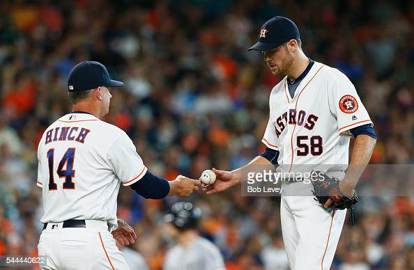 Manager AJ Hinch of the Houston Astros takes the ball from Doug Fister as he leaves the game in the fifth inning against the Chicago White Sox at...