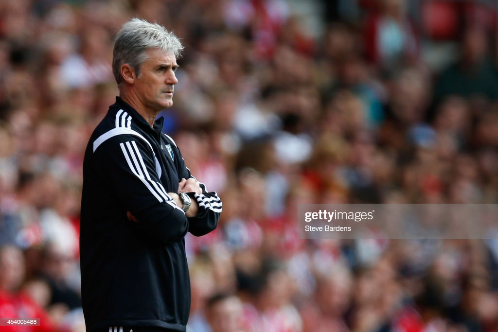 Manager Alan Irvine of West Brom looks on during the Barclays Premier League match between Southampton and West Bromwich Albion at St Mary's Stadium on August 23, 2014 in Southampton, England.
