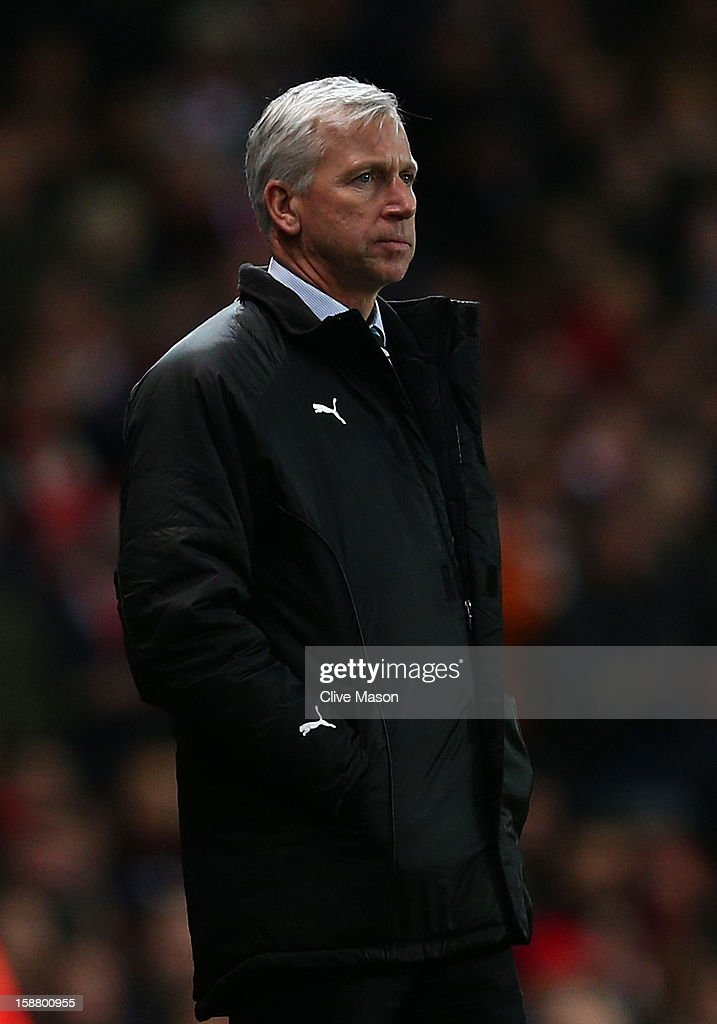 Manager Alan Pardew of Newcastle United looks on during the Barclays Premier League match between Arsenal and Newcastle United at the Emirates Stadium on December 29, 2012 in London, England.
